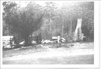 Black and white image of fire damaged home