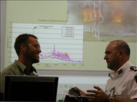 Justin Leonard, left, discusses his research with Michael Ross of the ACT Rural Fire Service.