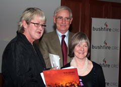 Bushfire CRC Chairman Len Foster with Mansfield Shire Mayor Marg Attley (left) and Wildfire in the High Country editor Robin Purdey, at the Mansfield launch