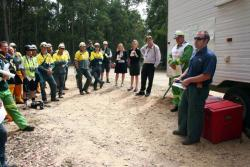 Researcher Matt Plucinski briefs the ground crews at the Wombat State Forest DC10 trial