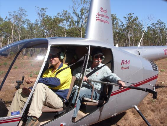 Dr Andrew Edwards boards the helicopter holding a spectrometer.