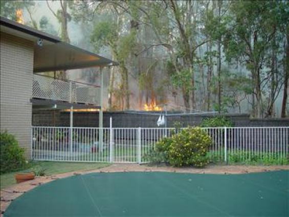 Fire over a backyard fence